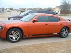 2006 Dodge Charger Daytona with all the badges removed and custom graphics from Signspecialists.