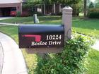 Our mailbox with new lettering and paint