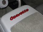 corvette lettering on seat backs of 82 corvette.  Cross flags on rear window.