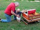 My dad and my son with his first wooden boat.