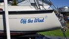 Aft quarter of Com Pac Eclipse sailboat